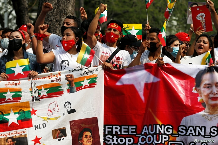 Myanmar citizens hold banners as they protest against the military coup in front of the UN office in Bangkok, Thailand February…