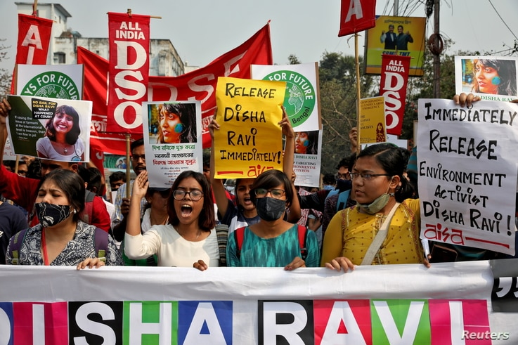 Demonstrators shout slogans during a protest against the arrest of 22-year-old climate activist Disha Ravi, in Kolkata, India, Feb. 23, 2021.