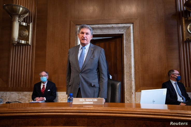 Chairman Joe Manchin, D-WV, speaks to Congresswoman Deb Haaland, D-NM, during the Senate Committee on Energy and Natural...