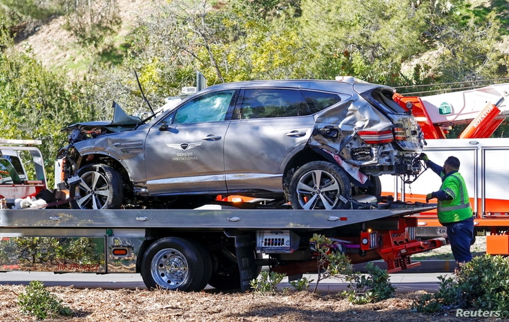 The damaged car of Tiger Woods is towed away after he was involved in a car crash, near Los Angeles, California.