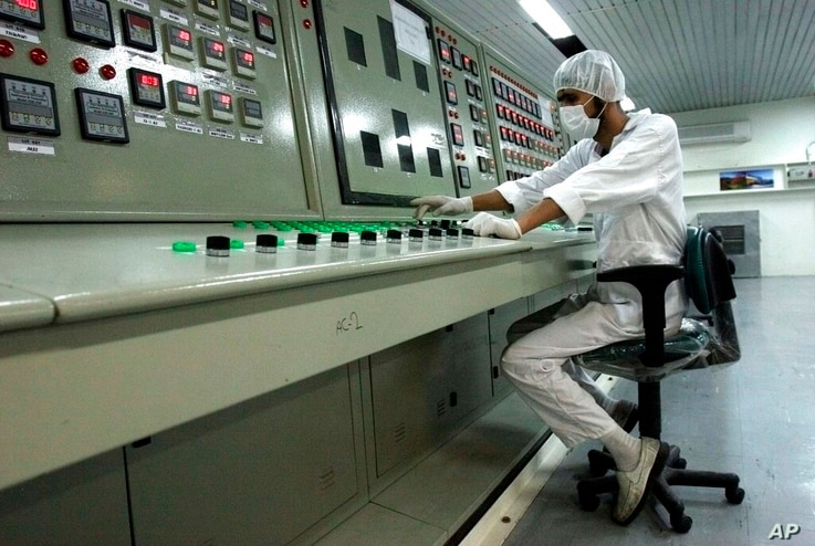 FILE - In this Feb. 3, 2007 file photo, a technician works at the Uranium Conversion Facility just outside the city of Isfahan,...