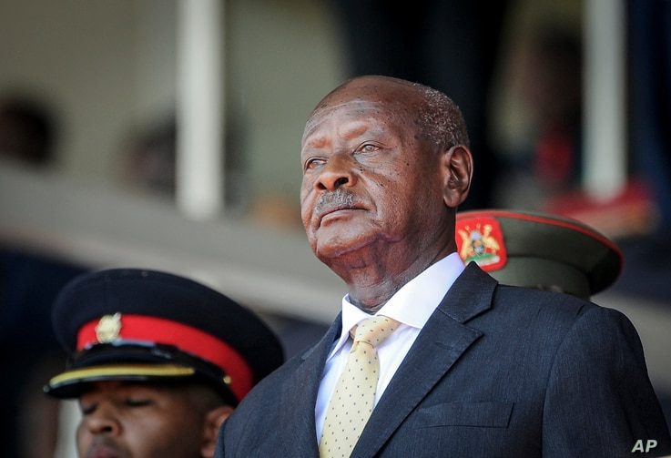 FILE- In this Feb. 11, 2020 file photo, Uganda's President Yoweri Museveni attends the state funeral of Kenya's former…