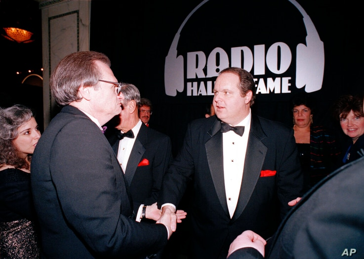Radio host Rush Limbaugh, right, is congratulated by Larry King at the Radio Hall of Fame induction ceremony at the Museum of…