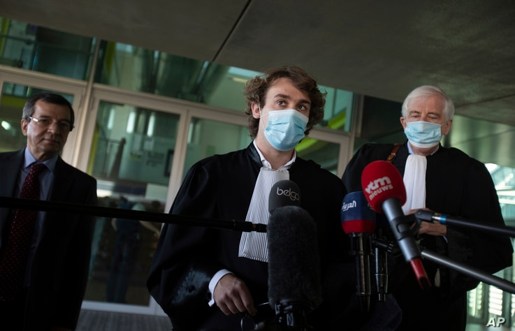 Lawyers George Henri Beauthier, right, and Rik Vanreusel, center, representing the National Council of Resistance of Iran,…