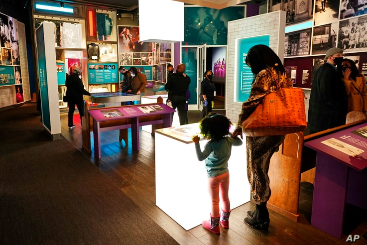 Visitors look at information presented at the National Museum of African American Music, Saturday, Jan. 30, 2021, in Nashville,…