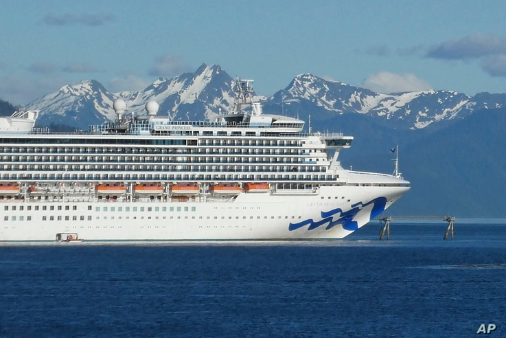 FILE - In this May 30, 2018, file photo, is the Grand Princess cruise ship in Gastineau Channel in Juneau, Alaska. The Canadian…