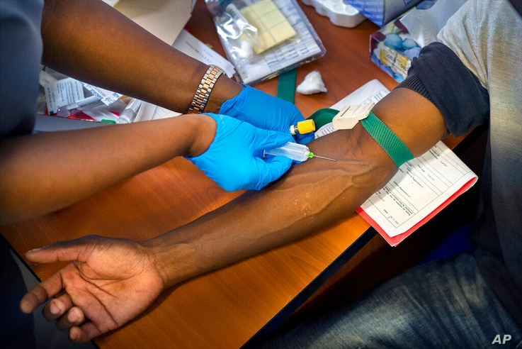 A clinical trials patient receives a dose of AstraZeneca test vaccine at the University of Witwatersrand' Soweto's Chris Sani…
