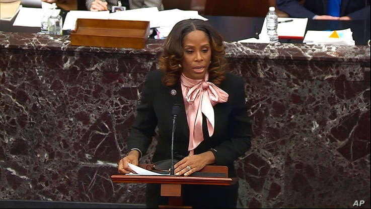 In this image from video, House impeachment manager Del. Stacey Plaskett, D-Virgin Islands, answers a question from Sen. Bob…
