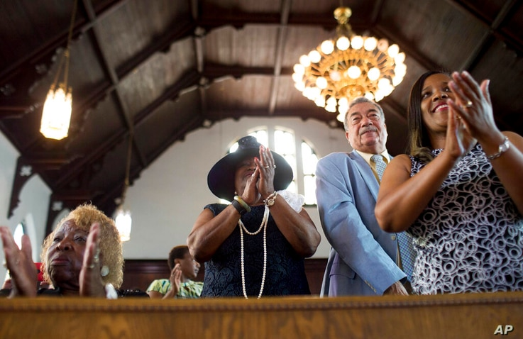 FILE - In this Sunday, July 10, 2016 file photo, parishioners clap during a worship service at the First Baptist Church, a…