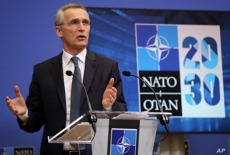NATO Secretary General Jens Stoltenberg speaks during a media conference ahead of a NATO defense minister's meeting at NATO...