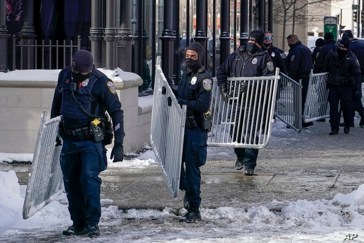 Police are seen outside The Pabst Theater Tuesday, Feb. 16, 2021, in Milwaukee, before President Joe Biden attends a town hall…