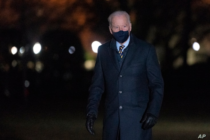President Joe Biden walks on the South Lawn of the White House after stepping off Marine One, Feb. 17, 2021, in Washington.