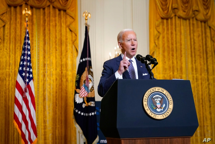President Joe Biden participates in a virtual event with the Munich Security Conference in the East Room of the White House,...