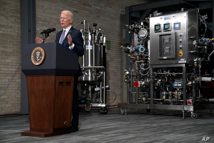 President Joe Biden speaks to the press after a tour of a Pfizer manufacturing site, Feb. 19, 2021, in Portage, Mich.