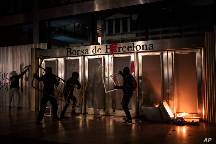 Demonstrators damage the Barcelona Stock Exchange building during a protest condemning the arrest of rap singer Pablo Hasel in...