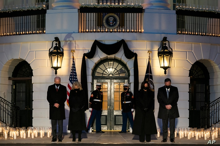 President Joe Biden, first lady Jill Biden, Vice President Kamala Harris, and Doug Emhoff participate in a moment of silence…