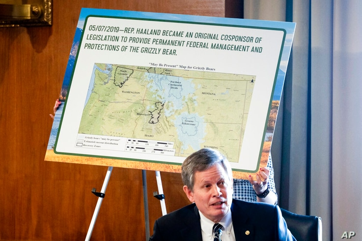 A board is put up as Sen. Steve Daines, R-Mont., speaks during the Senate Committee on Energy and Natural Resources hearing on...