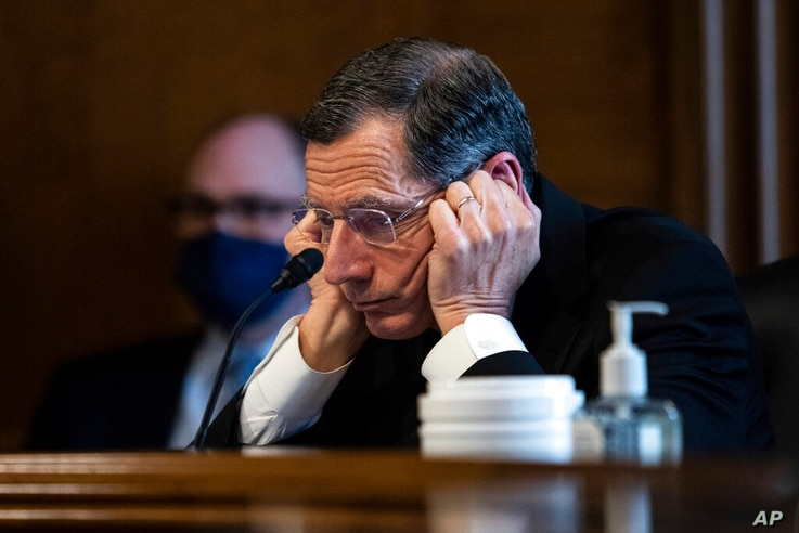 Senator John Barrasso, R-WY, listens to Rep. Deb Haaland, D-N.M., during a confirmation hearing before the Senate Committee on...