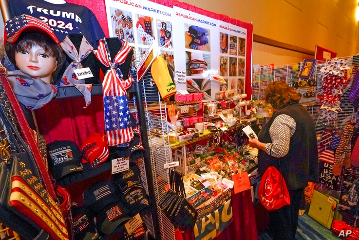 Conservative shirts, hats, ties and other items are displayed for sale at the merchandise show at the Conservative Political...
