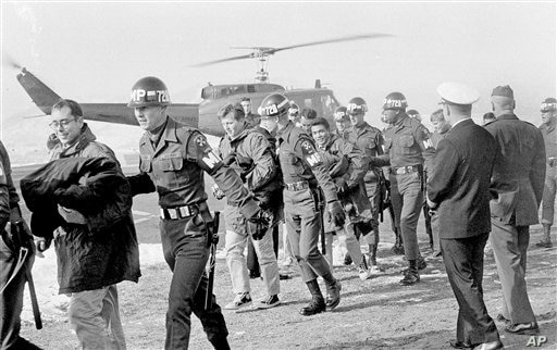 Released crewmen of the USS Pueblo are escorted by MPs upon their arrival at the U.S. Army 121st  Evacuation Hospital at Ascom…