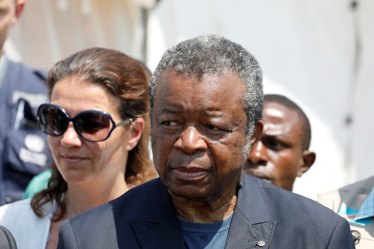 Closeup of Congolese government's Ebola response coordinator, Jean-Jacques Muyembe, with unidentified woman, in 2019.