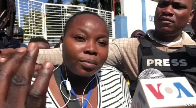 VOA Creole reporter Florence Lisene filed a complaint against National Police officers who attacked journalists covering protest