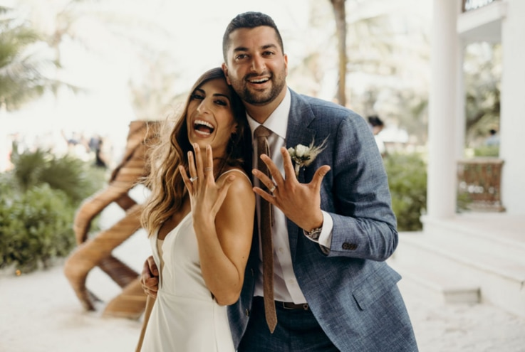 Leena and Nima Vaez show off their rings at their March 2020 wedding. (Photo courtesy Leena Vaez)