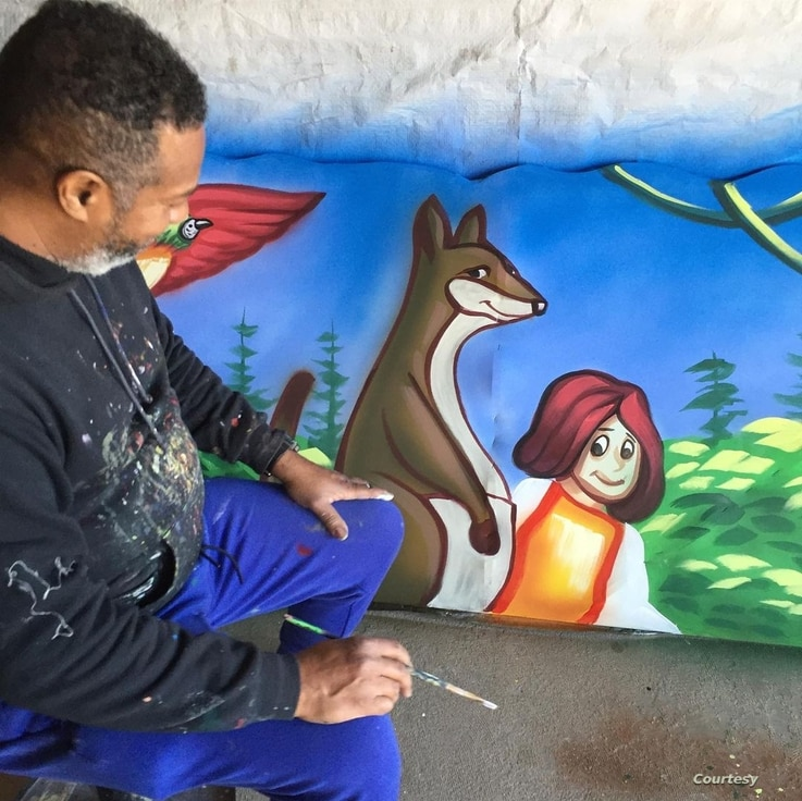 Mardi Gras artist Rene Pierre works on a piece of a house float, in New Orleans. (Courtesy photo)