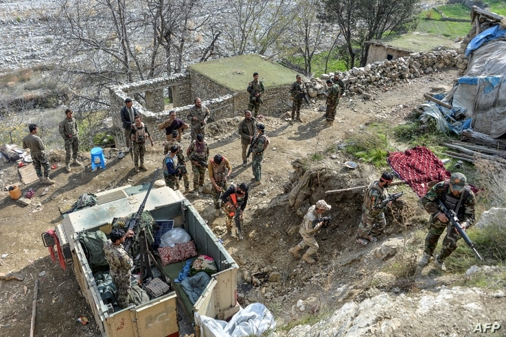 FILE - Afghan security forces take part in an ongoing operation against Islamic State (IS) militants in the Achin district of Nangarhar province, Nov. 25, 2019.