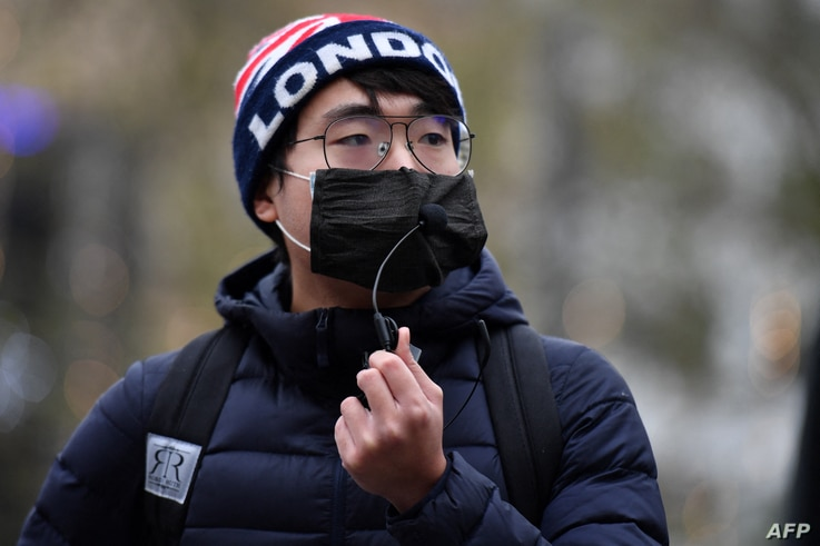 FILE - Simon Cheng, founder of Hongkongers in Britain, attends an event protesting shrinking political freedoms in Hong Kong, in Leicester Square, central London, Dec. 12, 2020.