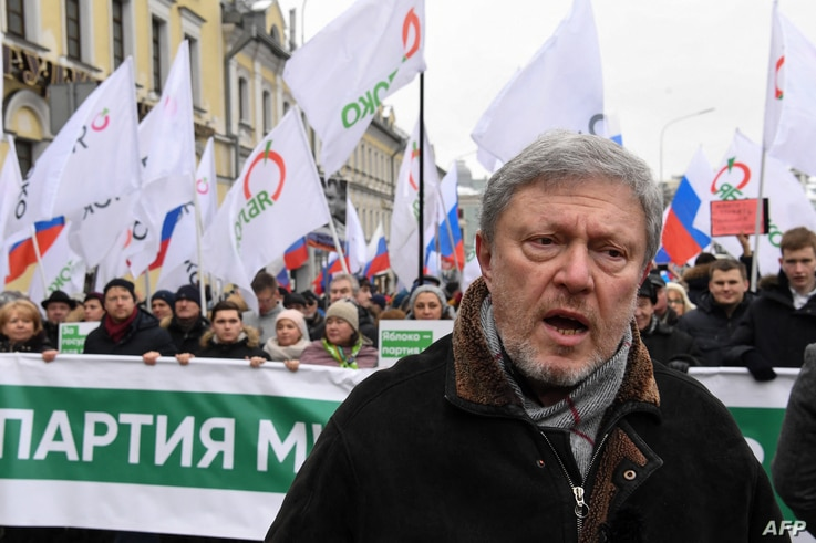 FILE - Liberal politician Grigory Yavlinsky participates in a march in memory of murdered Kremlin critic Boris Nemtsov, in central Moscow, Russia, Feb. 24, 2019.