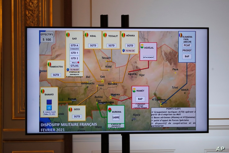 A map of French army locations in Sahel is pictured as French President Emmanuel Macron delivers his speech after a meeting via video-conference with leaders of the G5 Sahel, Feb. 16, 2021 in Paris.