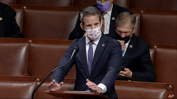 FILE - In this image from video, Republican Congressman Adam Kinzinger speaks at a House debate, at the U.S. Capitol in Washington, Jan. 7, 2021. (House Television via AP)