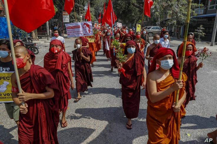 Buddhist monks lead a protest against the military coup in Mandalay, Myanmar on Tuesday, Feb. 16, 2021. Peaceful demonstrations…