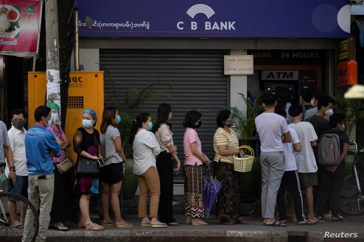People line up outside a bank branch in Yangon, Myanmar Feb. 1, 2021.