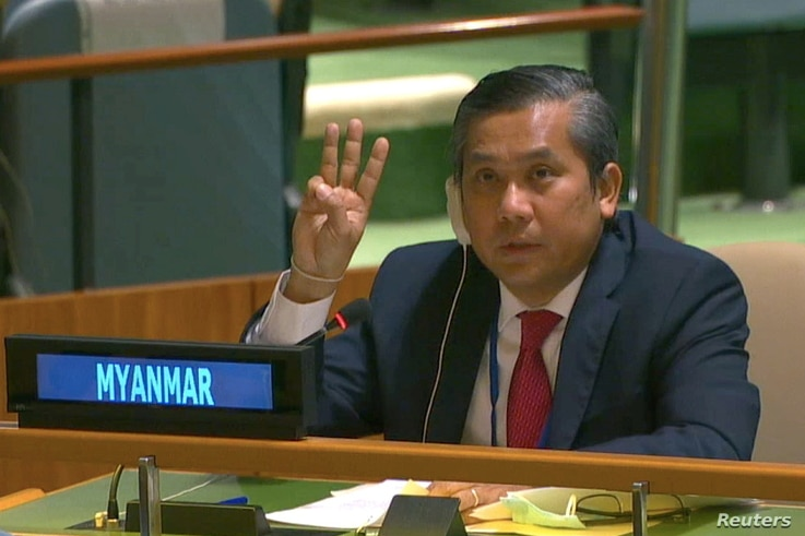 Myanmar's ambassador to the U.N. Kyaw Moe Tun holds up three fingers at the end of his speech to the General Assembly where he pleaded for international action in overturning the military coup in his country, at the U.N., in New York City, Feb. 26, 2021.