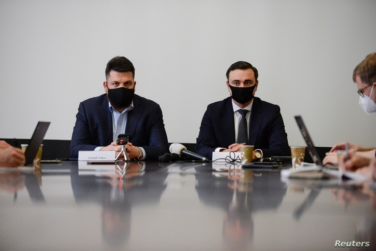 Leonid Volkov, Chief of Staff for Russian opposition leader Alexey Navalny, and Ivan Zhdanov, director of the Anti-Corruption Foundation, hold a press conference at the Permanent Representation of Lithuania to the EU, in Brussels, Belgium, Feb. 22, 2021.