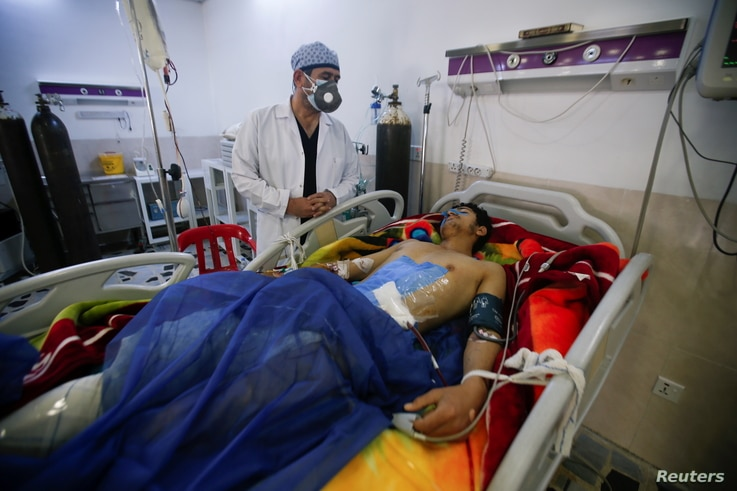 A man is treated at a hospital after he was injured during last night's rocket attack on U.S.-led forces in and near Irbil International Airport, in Irbil, Iraq, Feb. 16, 2021.