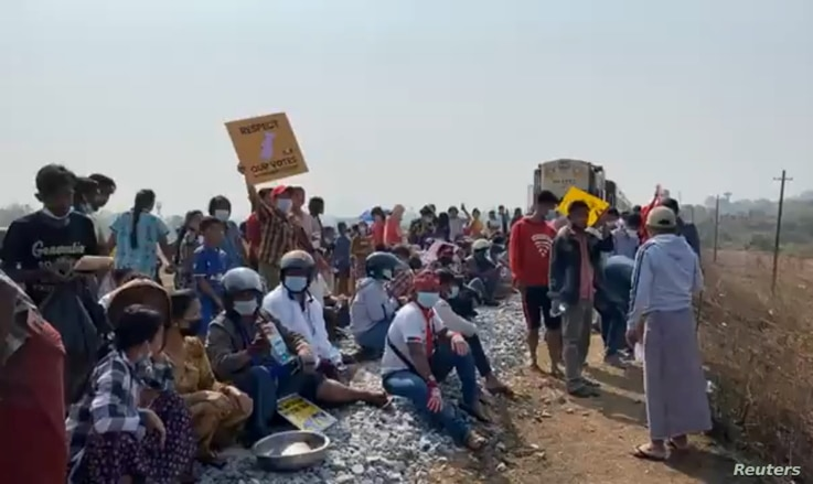 Protesters opposed to the military coup block the railway between Yangon and the southern city of Mawlamyine, Myanmar Feb. 16, 2021, in this still image taken from social media video.