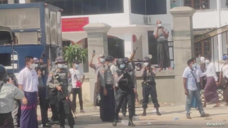Police officers hold riffles as they continue to disperse protesters outside the No. 1 Basic Education High School, in Myawaddy, Myanmar, Feb. 7, 2021 in this still image obtained from a video.