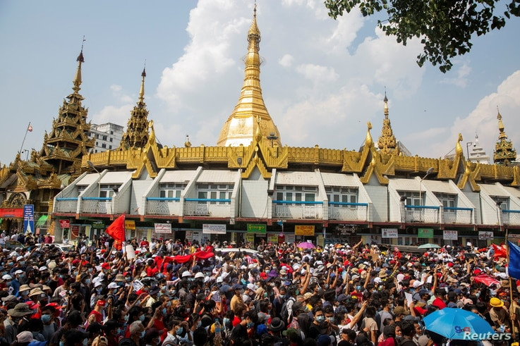 People rally in a protest against the military coup and to demand the release of elected leader Aung San Suu Kyi, in Yangon, Myanmar, Fe. 7, 2021.