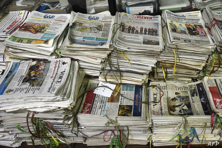 Various local newspapers are stacked in files at the newsroom of privately owned Myanmar Times newspaper in Yangon on October…