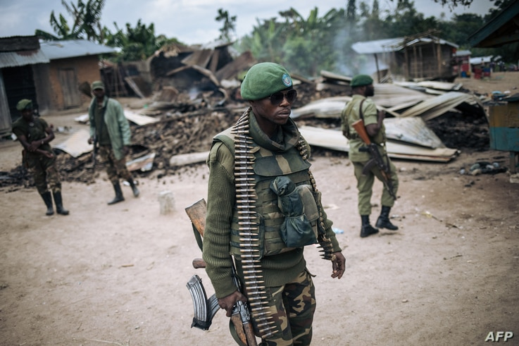An Armed Forces of the Democratic Republic of Congo (FARDC) soldier takes part in a foot patrol in the village of Manzalaho...
