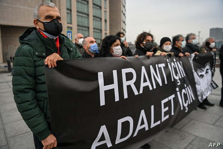 "Demonstrators hold a banner reading ""For Hrant, For Justice"" during a gathering in front of the Caglayan Courthouse in Istanbul…"