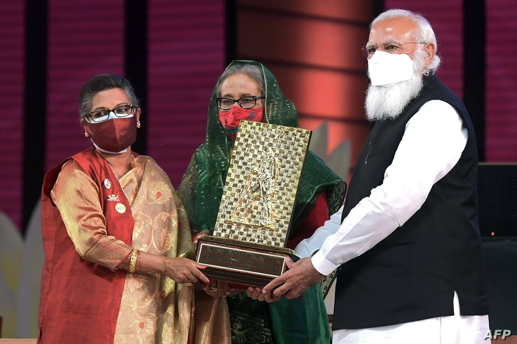 In this handout photo released by Bangladesh Prime Minister Office and taken on March 26, 2021 Indian Prime Minister Narendra…
