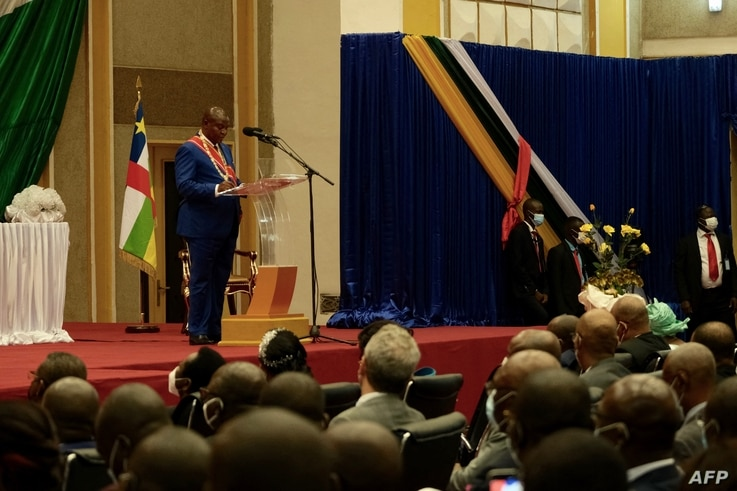 Central African Republic President Faustin Archange Touadéra (L back) delivers a speech during his inauguration ceremony in…