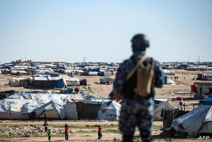 Special forces of the Syrian Democratic Forces keep watch on March 30, 2021 in the vicinity of al-Hol camp, the larger of two…