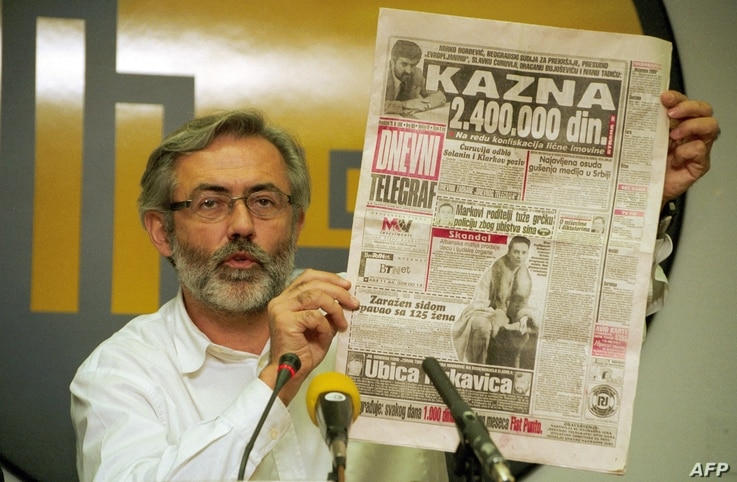 "This picture taken on November 1998 shows the editor and owner of the daily newspaper ""Dnevni Telegraf"" Slavko Curuvija at a…"