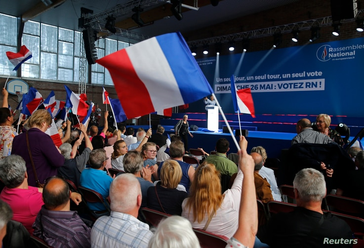 Supporters attend a rally of Rassemblement National party in Henin-Beaumont, France May 24, 2019. REUTERS/Pascal Rossignol