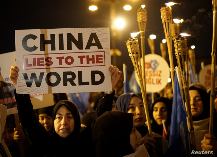 Protesters march in support of China's Uighurs and in solidarity with Arsenal midfielder Mesut Ozil after the furore caused by...